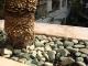 Rocks on grates over pots
