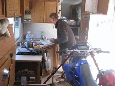 Glenn cooks breakfast.