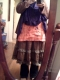 pink apron over three skirts and jeans