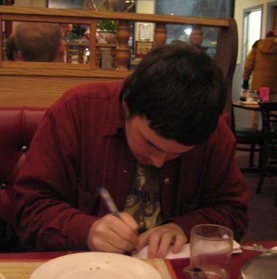 scribbling away