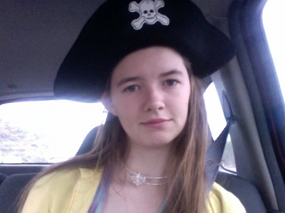 The necklace is acutely a flur headband. and there is a pirate hat